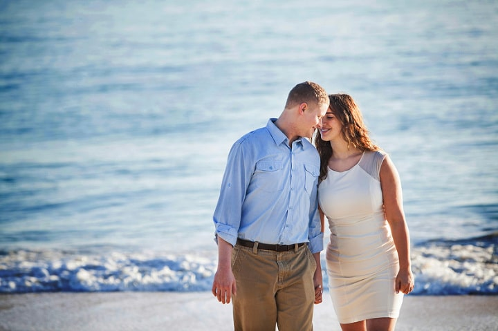 Couple on vacation in Hawaii take sunrise engagement photos at Waimanalo Beach